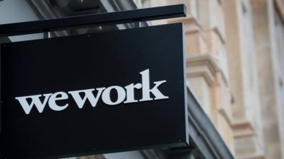 The WeWork logo is displayed outside of a co-working space in New York